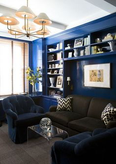 blue living room with dark sofa