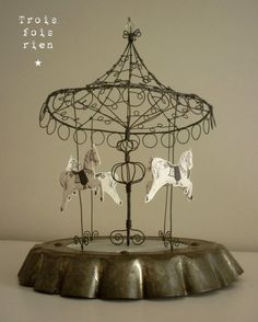 DIY carousel from a pie pan, lamp shade, wire, and horse cutouts. Mother in law would love it as a gift from the grandkids.