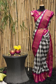 Printed blouse......Totally checking out the checks and giving them two thumbs up! Another truly amazing combination in Gadhwal pure silk sarees this season, with allover black and white checks in a plaid pattern and a stunning pink gold border with temple motifs. Just the stylish yet traditional saree you need to get you through the weddings and festivities this season.
