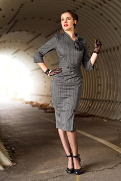 RetroCat wearing a grey 50s inspired wiggle dress designed by Idda van Munster for Miss Candyfloss.