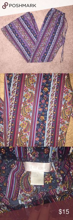 Hippie bell bottoms! Cute hippie bell bottoms! Have been worn numerous times but still in great condition, only flaw is one of the pant legs got torn so I cut it so it wouldn't drag but barely noticeable. They are more of a high waisted kind of pants Band of Gypsies Pants Boot Cut & Flare