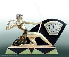 An Art Deco silvered and gilded metal (with ivorine bow) figural clock by Uriano, France 1930s #artdeco