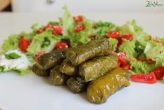 Greek Stuffed Vine Leaves - Dolmadakia Recipe: http://2brokevegans.com/greek-stuffed-vine-leaves-dolmadakia/