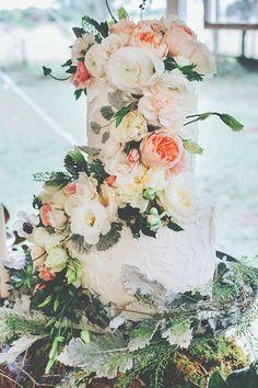 flower adorned wedding cake, photo by Papered Heart Photography ruffledblog.com/... #weddingcake #cakes