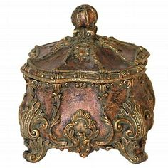 Our decorative box comes with lovely acanthus details and replete with designs and an appeal that is enchanting. Resin.