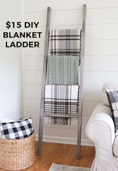 $15 blanket ladder that is really easy to build with just a drill! And it provides both living room storage and decor!