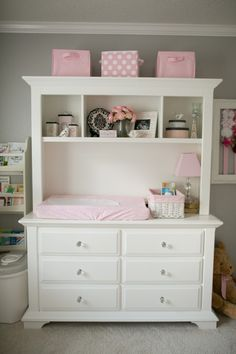 and Elegant Gray and Pink Nursery Dresser and hutch converted to a diaper changing table.Dresser and hutch converted to a diaper changing table.