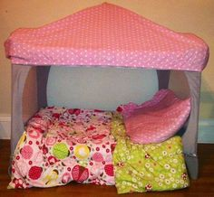Pack and play made into a tent bed!! Cut two long sides off and then cover with fitted sheet on top to create the tent, add pillows and blankets perfect place for kid to hangout!