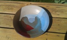 my very first plate - buff clay, sandstone, rust red and blue glaze