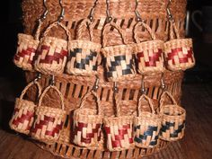 red and yellow cedar  basket earrings cedar weaving by Nicole Carle