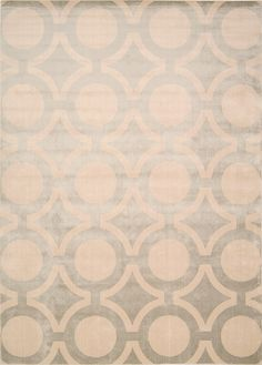 Perfect for the cutting edge studio or refined household, this elegantly styled area rug from the Luminance collection captures all that is modern in its design. An interlocking pattern of cream toned circles on a finely lined grey background make for a striking yet refined addition to any room's décor.