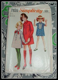 Simplicity 7835    Size 6    Chest: 25  Waist: 22    Childs shirt-dress. The shirt-dress has a back zipper, two piece collar and set-in
