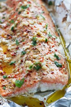 Garlic Butter Baked Salmon in Foil. Garlic Butter baked Salmon in Foil. This salmon is easy clean up a less than 30 minute meal and calls for less than 10 ingredients! Salmon In Foil Recipes, Fish Recipes, Seafood Recipes, New Recipes, Dinner Recipes, Cooking Recipes, Healthy Recipes, Oven Salmon Foil, Salmon In Foil Packets