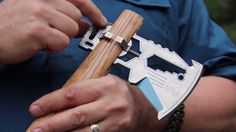 The KLAX titanium multi-tool axe head uses a custom made clamping system for easy dismantl...