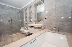 A minimal masterpiece, this bathroom feels ultra sleek with uniform tiles, a floating sink, and glass shower. Best Bathroom Designs, Bathroom Trends, Bathroom Renovations, Home Renovation, Bathroom Ideas, New York Penthouse, Grey Bathrooms, Modern Bathroom, Minimalist Home