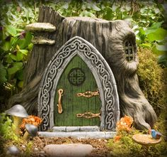 This Celtic design embellished Fairy Door offers a strong portal for your Irish (or not) fairies and wee folk that call your garden home.  Its