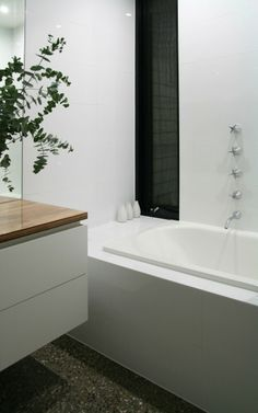 Fitzroy North House by Nic Owen Architects - black framed niche or window set in a white wall