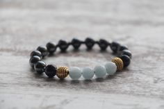 Aquamarine Beaded Bracelet, Black Agate Elegant bracelet, Hematite Bracelet, Healing bracelet, Gemstone Yoga Bracelet, Healing Crystals by KarolinaGJewelry on Etsy https://www.etsy.com/listing/580327835/aquamarine-beaded-bracelet-black-agate