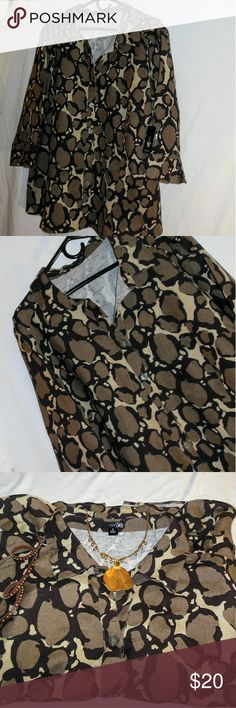 NWT Casual or Work Week 3x Blouse by East 5th Offered here is a new with tags animal or reptile print blouse in a 3X by East 5th. I can see this blouse being a casual outfit or something you might add to your work week. The colors are taupe Dash Brown, cream, and black. The original price was $40, which is still on the top but it hides between the arm and the hip area of the blouse. Please note that objects photographed with this blouse are not included. East 5th Tops Blouses