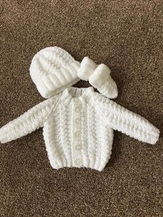 This knitted white baby cardigan set is a perfect coming home outfit for your baby. Would also make a nice baby gift, knit in baby soft dk wool. This particular listing is 14 chest and will fit a newborn baby up to approximately 1 month. As with all my listings i accept custom