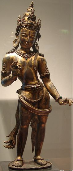 13th C. Nepal, Bodhisattva Manjushri, gilt copper inlaid with stones, by a Newar artist in Malla style. Guimet