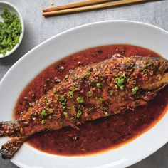 The first Chinese recipe I ever cooked was a version of this dish from Yan-Kit So's Classic Chinese Cookbook. Years later—and having eaten it countless times in the Sichuanese capital Chengdu—it remains one of my favorite fish dishes, and everyone else seems to love it too. The fish lies in a spectacular sauce, a deep rusty red in color, sumptuously spicy and aromatic with ginger and garlic. In Sichuan, they tend to make it with carp. Back         home in London, I've made it with sea bass…