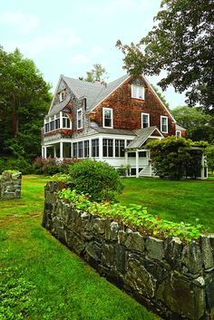 This late Shingle-style cottage captured the heart of a young family, who honored the past while making the interiors bright. Facade House, House Facades, House Exteriors, Stairs Balusters, Maine Beaches, Built In Bunks, Wood Shingles, Shelter Island, Painted Stairs