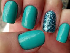 Turquoise nails with a glitter nail  I do this to my nails all the time! I like the different look :)