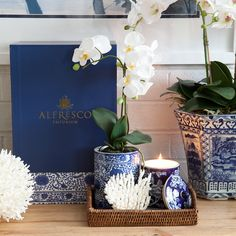 A perfect collage epitomising our signature style of elegance for your home, this hamper includes coral, an oriental rose candle, a vase with artificial orchid and a rattan tray. A classic combination of blue and white with a relaxed coastal touch.