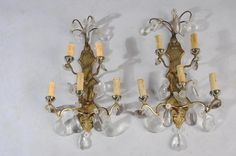 PAIRE D'APPLIQUES à 5 lumières sur 2 rangées en bronze doré agrémenté