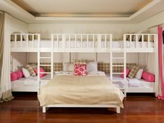 sleepover room, so cute for a large guest room - you could hang curtains in front of the bunks when not in use