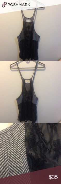 FREE PEOPLE Black Lace and Tweed Tunic Top Free People tank top with embroidered straps and low cut sides and a lace front and tweed like sides. Very boho and unique. Size small Free People Tops Tank Tops