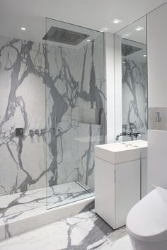 statement marble bathroom with contemporary fixtures-Lower East Side Apartment in NYC
