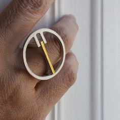 Ring Qt in silver with 18kt yellow gold door andreasschiffler