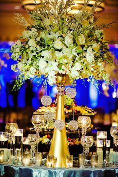 .Gold vase centerpiece but no the flowers maybe crystal hanging down.