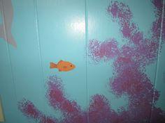 Orange fish near coral