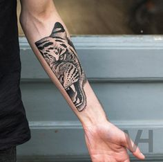 Tiger tattoo on forearm by Valentin Hirsch