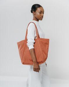 95ae2b22c0 An easy bag for daily toting. Top zipper closure. Detachable interior zip  pouch.
