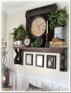 Mantel Decor by Ranelson. Like the use of greenery and clocks