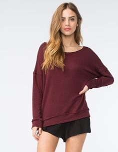 """Essentials by Full Tilt sweatshirt. Crafted from soft and cozy French terry, this sweatshirt has a cute, slouchy silhouette. It features dropped shoulders and long sleeves with ribbed cuffs and hem. 54% polyester/44% rayon/2% spandex. Machine wash. Imported.<BR><BR>Model is wearing a size small. Model measurements:<BR>Height: 5'8""""<BR>Chest: 34""""<BR>Waist: 23""""<BR>Hips: 34"""""""
