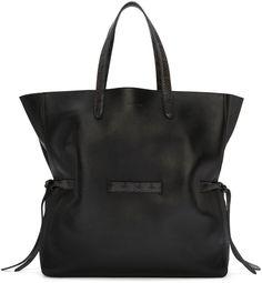 Buffed leather tote bag in black. Watersnake-embossed trim in grey throughout…