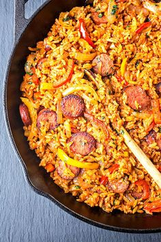 ... of smoked sausage and red rice with charred onions and peppers