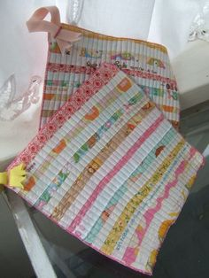 Selvedge pot holders. Could also just make w/ fabric strips. She has chosen cute colors here!