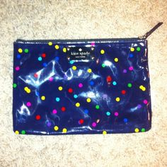 Authentic Kate Spade cosmetic case- accessory bag! Authentic kate spade accessory bag- cosmetic case/ inside is very clean/ outside shows use/ but it's the type of material you can wipe down :) adorable!! kate spade Bags Cosmetic Bags & Cases