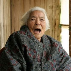 Happiness is a U-shaped curve. We tend to start out pretty happy in our 20's, drop to the lowest levels of happiness in our 50 and then progressively get happier. In Okinawa the happiness cohort are centenarians. Here Kamata-San laughs at her own joke...