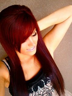 Auburn red hair, side swept bangs