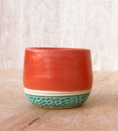 Coral Line Petite Stoneware Cup | This spry little stoneware cup is finished with a satin coral ... | Coffee & Tea Cups