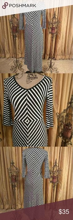 APRICOT LANE BOUTIQUE Dress PRACTICALLY VINTAGE...This dress features a black and white stripe print that forms a diamond shape in middle of dress. 3/4 sleeve and midi length. NWT. Brand new condition. Please message for specific details♤ Apricot Lane Boutique Dresses