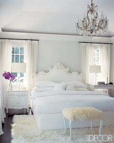 all white bedroom with chandelier