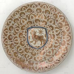 Plate Date: 1450–1470 Geography: Made in probably Manises, Valencia, Spain Culture: Spanish Medium: Tin-glazed earthenware Dimensions: 2 13/16 x 17 5/8 in. (7.1 x 44.7 cm)